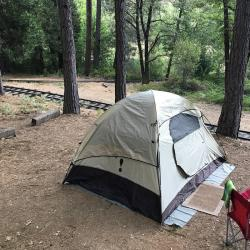 Inn Town Campground tent and railroad